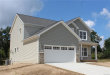 Photo of 941 RIVER ROCK DR, Holly, MI 48442 (MLS # 21393685)