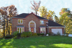 Photo of 37549 GLENGROVE DR, Farmington Hills, MI 48331 (MLS # 21395843)