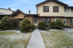 Photo of 8401 18 Mile Rd., Unit # 13, Sterling Heights, MI 48313 (MLS # 31370517)