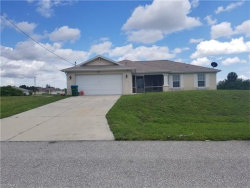 Photo of 304 NW 21st ST, Cape Coral, FL 33993 (MLS # 217051944)