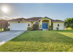 Photo of 124 NW 26th PL, Cape Coral, FL 33993 (MLS # 217071988)