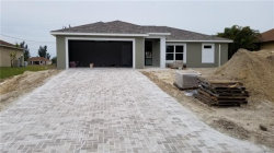 Photo of 120 NW 15th ST, Cape Coral, FL 33993 (MLS # 217078718)
