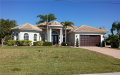 Photo of 613 SE 4th PL, Cape Coral, FL 33990 (MLS # 218020295)