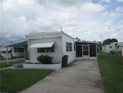 Photo of 135 Amber AVE, North Fort Myers, FL 33917 (MLS # 218048479)