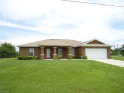 Photo of 13 NW 24th PL, Cape Coral, FL 33993 (MLS # 218049074)