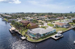 Photo of 111 SW 57th ST, Cape Coral, FL 33914 (MLS # 218073107)