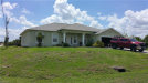 Photo of 2309 NE 22nd AVE, Cape Coral, FL 33909 (MLS # 218079509)