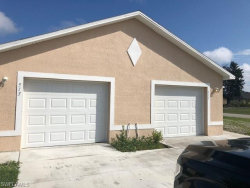 Photo of 517 W Nicholas PKY, Cape Coral, FL 33991 (MLS # 218080956)