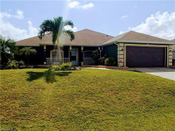 Photo of 410 NW 9th TER, Cape Coral, FL 33993 (MLS # 219013841)
