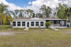 Photo of 10660 Sharon DR, North Fort Myers, FL 33917 (MLS # 219017557)