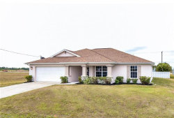 Photo of 712 NW 7th PL, Cape Coral, FL 33993 (MLS # 219021660)