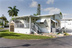 Photo of 11791 Dawn Cowrie DR, Fort Myers, FL 33908 (MLS # 219042997)