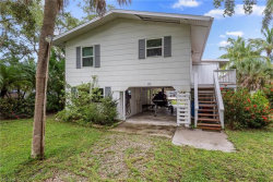 Photo of 121 Falkirk ST, Fort Myers Beach, FL 33931 (MLS # 219047497)