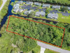 Photo of 4510 Brownie RD, Port Charlotte, FL 33953 (MLS # 219049802)
