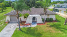 Photo of 848 NW Dobell TER, Port Charlotte, FL 33948 (MLS # 219053131)