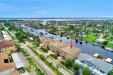 Photo of 1640 Beach PKY, Unit 102, Cape Coral, FL 33904 (MLS # 219054237)