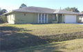 Photo of 909 Mckinley AVE, Lehigh Acres, FL 33972 (MLS # 220006290)