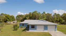 Photo of 14680 Smokey Hollow LN, North Fort Myers, FL 33903 (MLS # 220013117)
