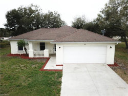 Photo of 101 Teakwood CT, Lehigh Acres, FL 33974 (MLS # 220015245)