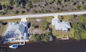 Photo of 10348 Atenia ST, Port Charlotte, FL 33981 (MLS # 220033144)