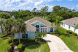 Photo of 9174 Palm Island CIR, North Fort Myers, FL 33903 (MLS # 220038378)