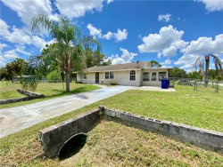 Photo of 1023 Broadway AVE, Lehigh Acres, FL 33972 (MLS # 220039553)