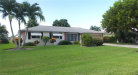 Photo of 1820 SE 13th Terrace, CAPE CORAL, FL 33990 (MLS # 220042296)
