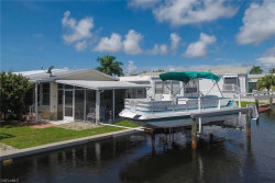 Photo of 14 Galleon Way, FORT MYERS BEACH, FL 33931 (MLS # 220056107)