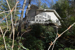 Photo of 7783 E Wolfcreek Rd, Clayton, GA 30525 (MLS # 8585692)
