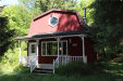 Photo of 6919 Poverty Hill Road, Ellicottville, NY 14731 (MLS # B1196417)