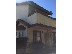 Photo of 132 Poxon Place , Unit 12, West Covina, CA 91790 (MLS # CV18251311)