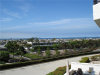 Photo of 280 Cagney Lane , Unit 211, Newport Beach, CA 92663 (MLS # FR18216942)