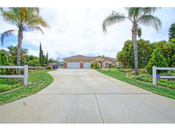 Photo of 18019 TWIN LAKES DR, Riverside, CA 92508 (MLS # IG19061051)