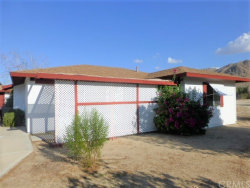 Photo of 6985 Estrella Avenue, 29 Palms, CA 92277 (MLS # JT17215926)