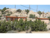 Photo of 5675 Old Woman Springs Road, Yucca Valley, CA 92284 (MLS # JT17231993)
