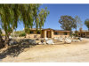 Photo of 10645 Stagecoach Road, Morongo Valley, CA 92256 (MLS # JT18108430)