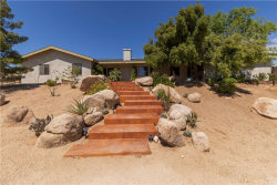 Photo of 5598 Palm Avenue, Yucca Valley, CA 92284 (MLS # JT19115349)