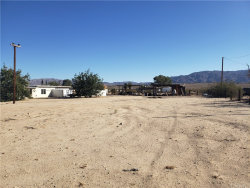 Photo of 73279 Raymond Way, 29 Palms, CA 92277 (MLS # JT19203246)