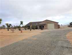 Photo of 3775 Avalon Avenue, Yucca Valley, CA 92284 (MLS # JT19276644)