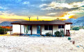 Photo of 4606 Avenida Del Sol, Joshua Tree, CA 92252 (MLS # JT20169924)