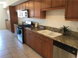 Photo of 17168 Newhope Street , Unit 213, Fountain Valley, CA 92708 (MLS # OC18105091)