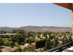 Photo of 24055 Paseo Del Lago , Unit 1357, Laguna Woods, CA 92637 (MLS # OC18200307)