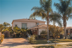 Photo of 13232 S Saint Andrews Place, Gardena, CA 90249 (MLS # PW20220509)