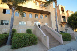 Photo of 6100 Rugby Avenue , Unit 102, Huntington Park, CA 90255 (MLS # RS19012377)