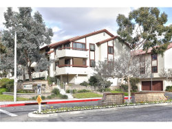 Photo of 18145 American Beauty Drive , Unit 104, Canyon Country, CA 91387 (MLS # SR18050514)