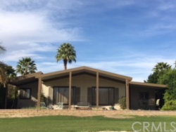 Photo of 73450 Country Club Drive , Unit 297, Palm Desert, CA 92260 (MLS # IV18031885)