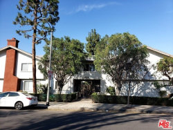 Photo of 18611 Collins Street, Unit E22, Tarzana, CA 91356 (MLS # 19429712)