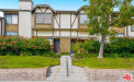 Photo of 21153 Lassen Street, Unit 4, Chatsworth, CA 91311 (MLS # 20560644)