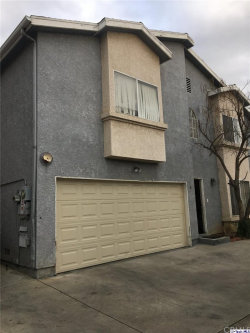 Photo of 12120 Terra Bella Street, Unit 16, Pacoima, CA 91331 (MLS # 320000057)
