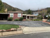 Photo of 661 Canyon Crest Drive, Sierra Madre, CA 91024 (MLS # AR19040864)